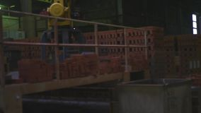 Warehouse brick brick factory. Haren finished brick warehouse in the factory stock video