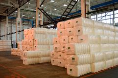 Warehouse with a bunch of huge, white, rectangular bags with acrylic Stock Images
