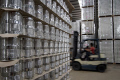 Warehouse cans. Worker is working in the warehouse cans Royalty Free Stock Image
