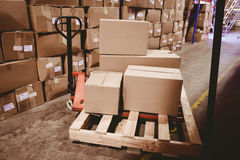 Warehouse with cardboard boxes Stock Image