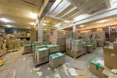 Warehouse with cardboard boxes Stock Images