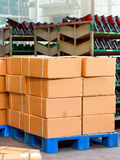 Warehouse and carton. Factory warehouse, some shelves and a pile of cardboard boxes Royalty Free Stock Photography