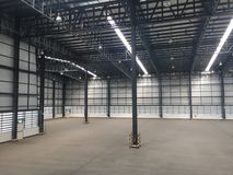 A warehouse is a commercial building for storage of goods. Logistics, perspective, plant, modern, architecture, iron, lamp, large, light, room, space stock photo