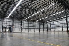 A warehouse is a commercial building for storage of goods. Stock Photos