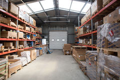A warehouse is a commercial building for storage of goods. Warehouses are used by manufacturers, importers, exporters, wholesalers. Transport businesses Royalty Free Stock Images