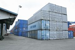 Warehouse containers. Containers stacked outside port warehouse stock photo