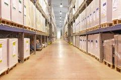 Warehouse corridor. Long corridor with shelves in distribution warehouse royalty free stock photography