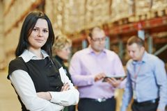 Warehouse crew at work. Female manager and workers in warehouse royalty free stock photo