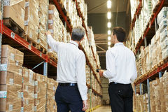 Warehouse crew at work. Two managers workers in warehouse with bar code scanner royalty free stock photo