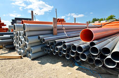 Warehouse depot for pipes. Stack of industrial pipes for water transportation. Warehouse outdoor storage depot stock images