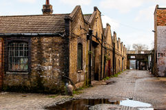 Warehouse in disrepair in a London alley. Abandoned work place Stock Image