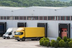 Warehouse distribution center. Logistics center. Trucks in warehouse distribution center stock image