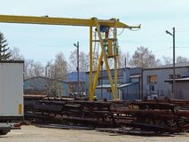 Warehouse and distribution of metal products under the open sky. Loading rail crane and car in the warehouse. Metallurgical branch stock photos