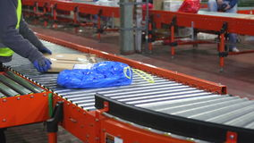 Warehouse Distribution. Sorting and Shipping Parcels at Conveyer in Distribution Warehouse