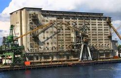 Warehouse docks and cranes Royalty Free Stock Photo