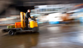 Warehouse dolley Vehicle in motion blur. A warehouse dolley vehicle in motion blur while moving at a fast speed down the street Stock Photo