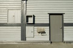Warehouse door. Old grey wooden warehouse, with steel sink Royalty Free Stock Photography