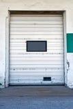 Warehouse door on dirty wall Stock Image