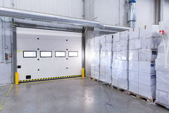 Warehouse door or gate and cargo boxes Royalty Free Stock Images
