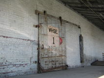 Warehouse Door with Pulley. Weathered Warehouse Door with pulley royalty free stock photo