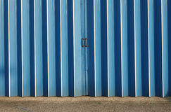Warehouse Doors. Detail of blue industrial doors on a warehouse Stock Photo
