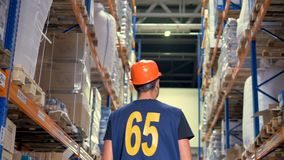 Warehouse employee during inspection. stock footage