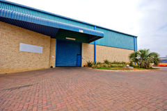 Warehouse exterior. Entrance and exterior of commercial warehouse Stock Images