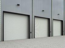Warehouse exterior con las puertas del obturador Fotografía de archivo
