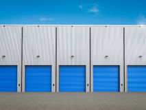 Warehouse exterior with shutter doors. 3d rendering warehouse exterior with shutter doors Royalty Free Stock Photography