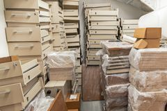 Warehouse filled with office furniture. Warehouse filled with office furniture stock photography
