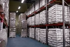 Warehouse of finished products in paper bags stock image