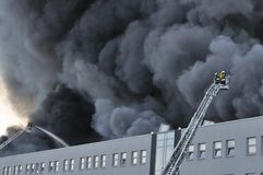 Warehouse fire. Firefighters extinguish a raging fire in a China Mart storehouse, May 10, 2011 in Wolka Kosowska, Poland. The fire burned 150 storage units Stock Images