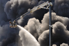 Warehouse fire. Firefighters extinguish a raging fire in a China Mart storehouse, May 10, 2011 in Wolka Kosowska, Poland. The fire burned 150 storage units Royalty Free Stock Image