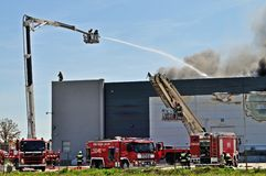 Warehouse fire. Firefighters extinguish a raging fire in a China Mart storehouse, May 10, 2011 in Wolka Kosowska, Poland. The fire burned 150 storage units Royalty Free Stock Photos