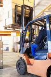 Warehouse forklift loader work Stock Images