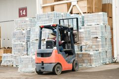 Warehouse forklift loader at work Royalty Free Stock Photos