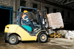 Warehouse forklift loader works Royalty Free Stock Photo