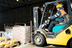 Warehouse forklift loader works Royalty Free Stock Photos