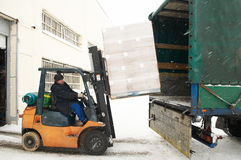 Warehouse forklift loading a car Stock Photography