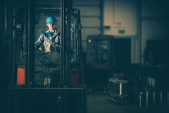 Warehouse Forklift Operator Stock Photo