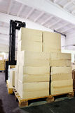 Warehouse forklift stacker with boxes Stock Photos