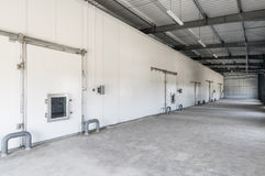 Warehouse freezer in the factory. Big freezer warehouse at the plant. facade with industrial freezer warehouse door Stock Images