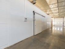 Warehouse freezer in the factory. Large freezer storage in the factory. closed door from warehouse stock photo