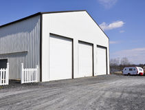 Warehouse garage. Three garage doors for a large warehouse building royalty free stock photo