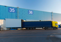 Warehouse gates and truck loading Stock Images