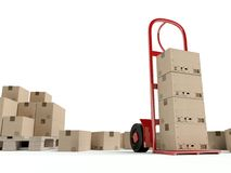 Warehouse hand truck and many cardboard boxes Royalty Free Stock Images