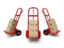 Warehouse hand trucks with cardboard boxes Royalty Free Stock Photography