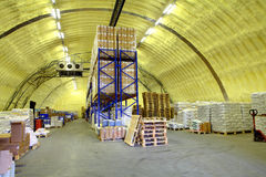 Warehouse hangar of polyurethane foam, storage hangar with shelves and goods Stock Photography