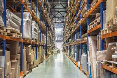 Warehouse or hangar storage racks or shelves with boxes and goods. Industrial logistic delivery and distribution. Concept royalty free stock photography