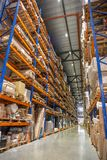 Warehouse or hangar storage racks or shelves with boxes and goods. Industrial logistic delivery and distribution. Concept royalty free stock photos